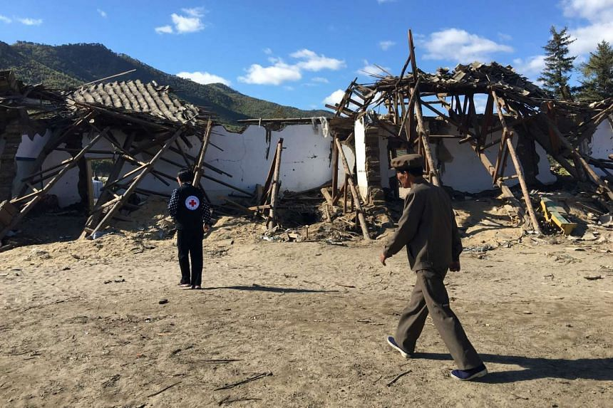A handout photo taken on Sept 28, 2016 shows the devastation to a village in Hoeryong, North Korea after floods struck the area in August.