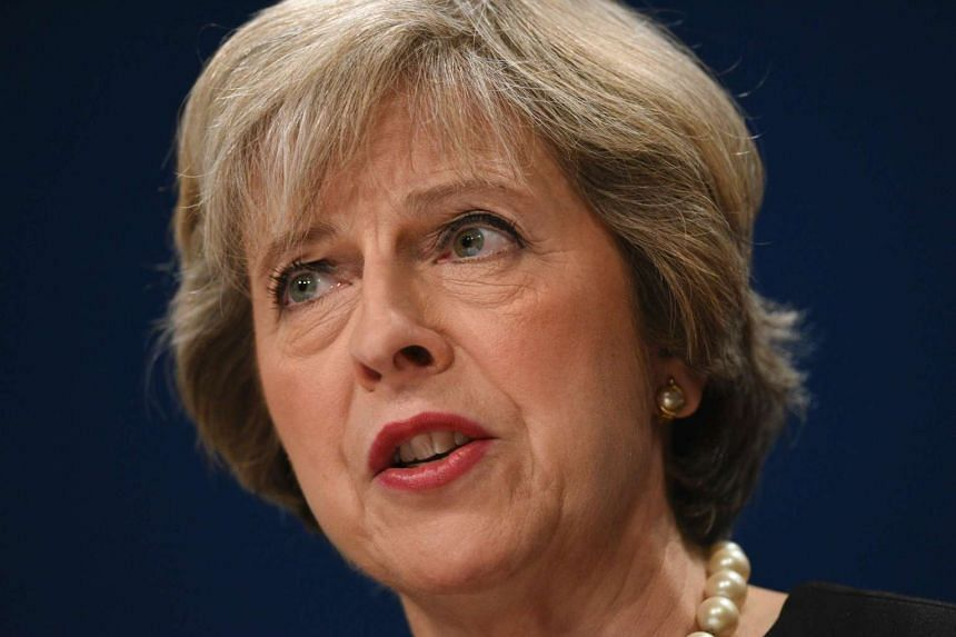 Britain's Prime Minister Theresa May delivering a speech on the first day of the Conservative party annual conference at the International Convention Centre in Birmingham, central England, on Oct 2.