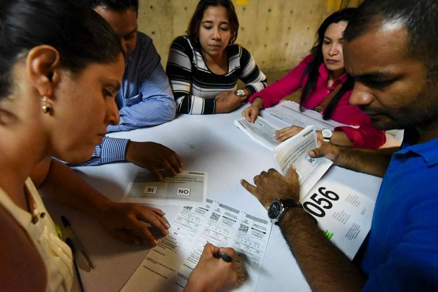 Electoral officials counting votes after a referendum on whether to ratify a historic peace accord to end Colombia's 52-year war between the state and the communist Farc rebels, in Cali, Colombia, on Oct 2, 2016.