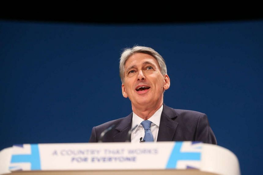 Finance minister Philip Hammond said on Oct 3 that Britain will guarantee to cover any European Union funding secured ahead of the country's exit from the bloc.
