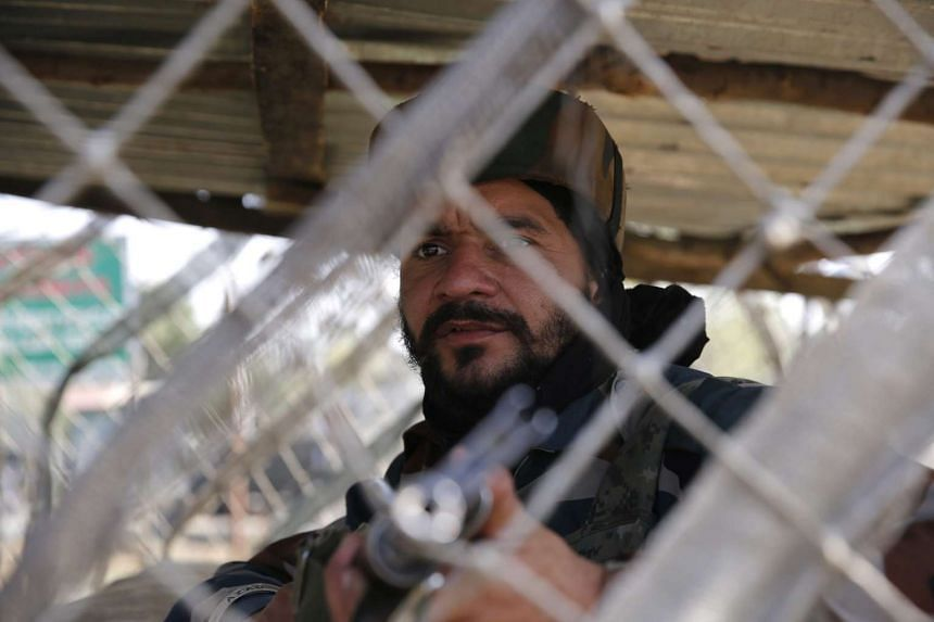 An Indian army soldier on guard in front of the army camp which was attacked by the militants in Baramulla on Oct 3, 2016.