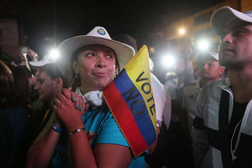 'No' supporters at a rally after their victory in the referendum to end the 52-year-old guerrilla war between the FARC and the state on Oct 2, 2016 in Bogota, Colombia.