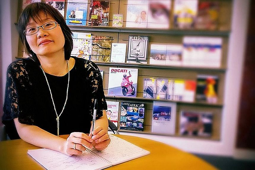 """Ms Ng has enjoyed reading the news from a young age. She hopes for a strong kampung spirit and racial harmony for Singapore and that """"we never lose our Singlish""""."""