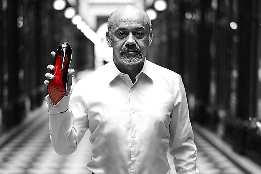 French designer Christian Louboutin's footwear comes with his signature red-lacquered soles.