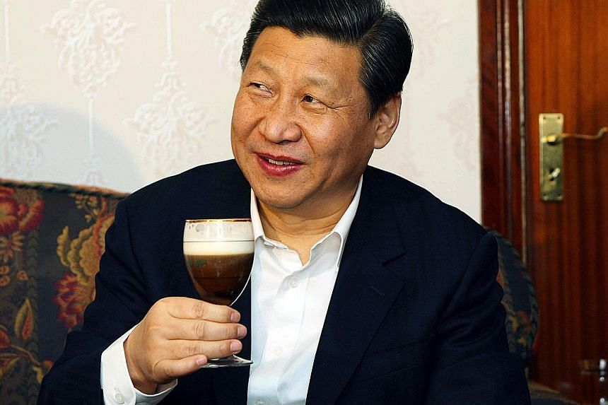 Mr Xi trying an Irish coffee during a visit to Lynch Farm in Ireland in 2012. When Mr Xi consumes a food item, its sales in China soar.