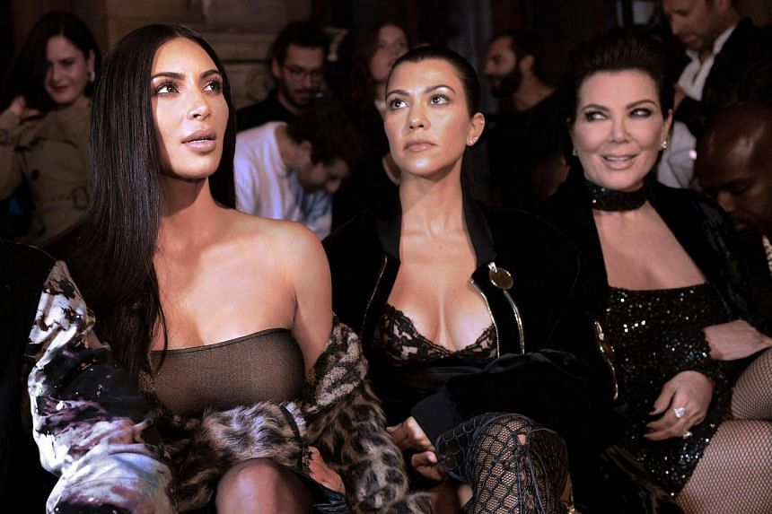 (From left) Kim Kardashian, Kourtney Kardashian and Kris Jenner attending the Off-white 2017 Spring/Summer ready-to-wear collection fashion show, on Sept 29, 2016 in Paris.
