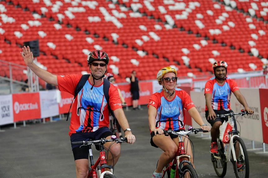 Cyclists returning to the end point at the National Stadium.