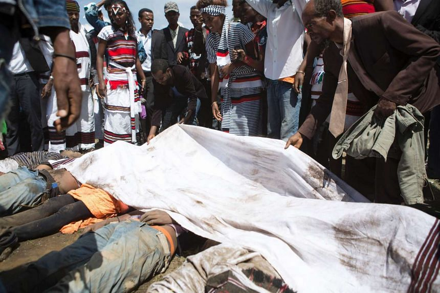 A man covers corpses of festival goers killed during a stampede in Bishoftu, on Sunday (Oct 2, 2016).