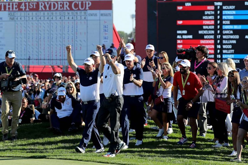 Vice-captain Bubba Watson, JG Holmes, Jimmy Walker and Rickie Fowler of the US celebrate as the United States win the Ryder Cup on Sunday (Oct 2, 2016).
