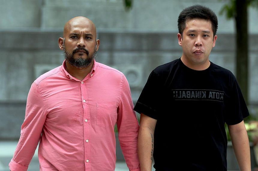 Bike shop owner Eric Khoo Shui Yan (right) and project manager Zulkifli Awab were each jailed for seven days and fined $5,000 on Tuesday (Oct 4) for organising and promoting illegal bicycle races without police approval and permits.
