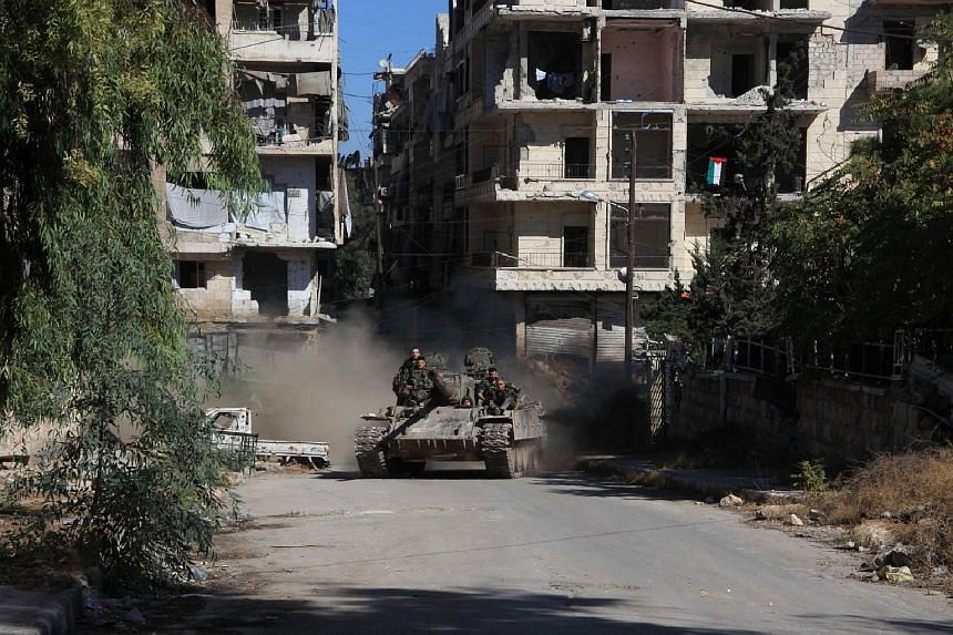 Syrian pro-government forces in Aleppo's Suleiman al-Halabi neighbourhood on Sept 30, 2016.