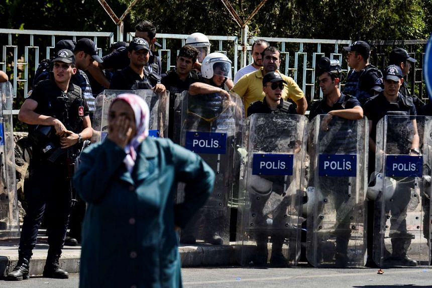 Turkish police look on during a protest in Diyarbakir on Sept 9, 2016.