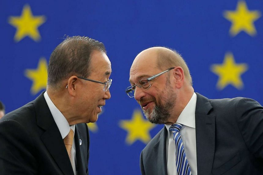 UN Secretary General Ban Ki Moon (left) with European Parliament President Martin Schulz after the European Parliament vote in favor of the Paris climate change agreement on Oct 4, 2016.