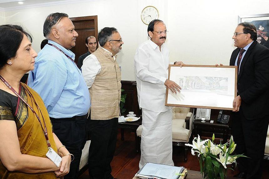 Mr Iswaran (far right) meeting Indian minister M. Venkaiah Naidu in New Delhi yesterday. With the two ministers are (from left) Dr Nandita Chatterjee, Secretary of the Ministry of Housing and Urban Poverty Alleviation; Mr Ajay Mittal, Secretary of th