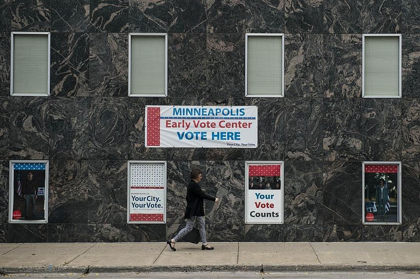 A vote centre in Minneapolis, Minnesota. Voter turnout has been a big problem for decades in the US. Since 1980, it has hovered between 48 and 57 per cent for US presidential elections.