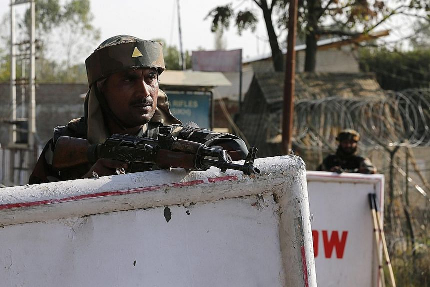 Indian soldiers standing guard at the army camp in Baramulla in Indian Kashmir that was attacked in an overnight militant raid.