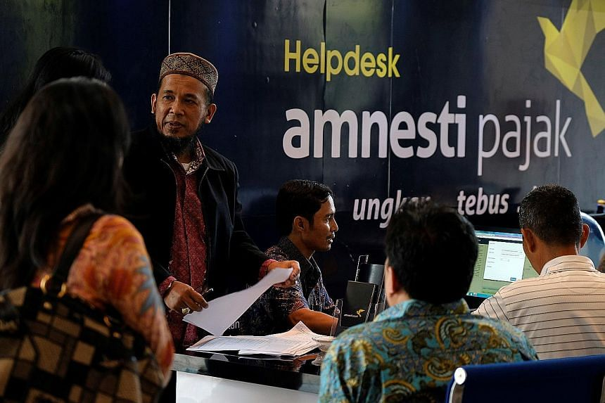 People waiting at a help desk for tax amnesty at Indonesia's tax headquarters in Jakarta last Friday, when the first phase of the nine-month scheme ended. The bulk of offshore wealth that Indonesian taxpayers have declared and sent home under the amn