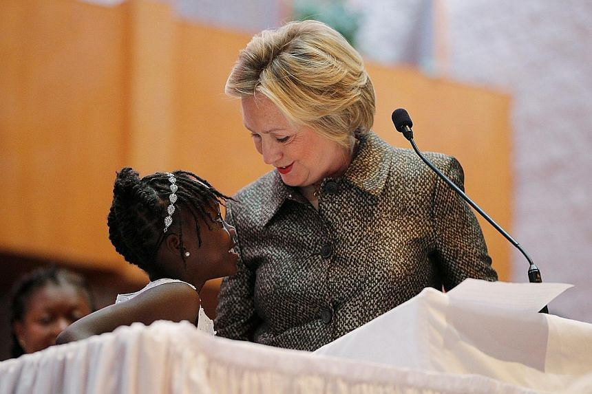 Zianna Oliphant, nine, joining Mrs Clinton at the pulpit in Little Rock AME Zion Church in Charlotte, North Carolina, on Sunday. Zianna had testified before the Charlotte City Council about violence in her community.