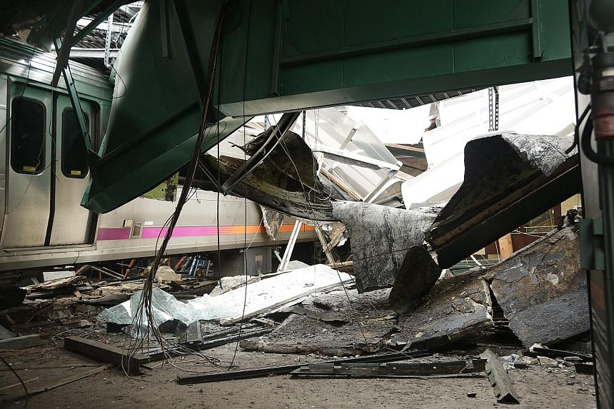 The derailed train, which killed a 34-year-old woman on the platform and injured 108 people at a Hoboken station last Thursday.