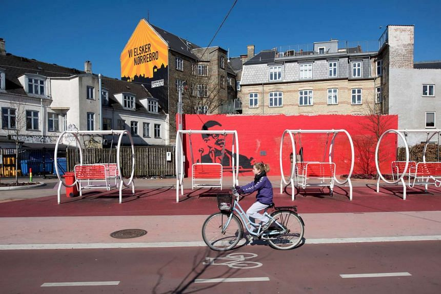 A girl rides a bicycle at Superkilen park in Copenhagen, Denmark, which won the Aga Khan Award for Architecture.