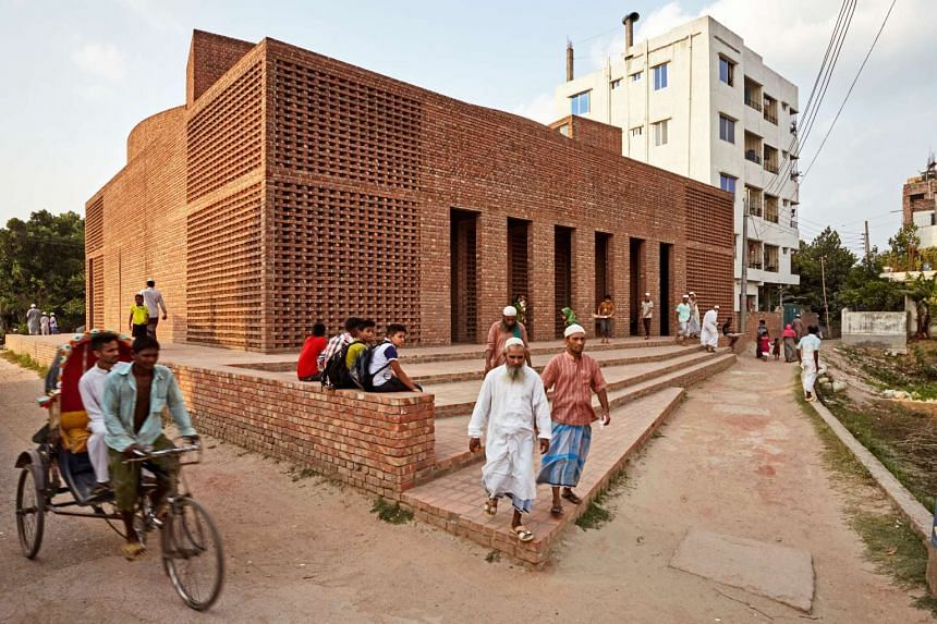 People leave Bait Ur Rouf Mosque in Dhaka, Bangladesh. The mosque was one of the winners of this year's Aga Khan Award for Architecture.