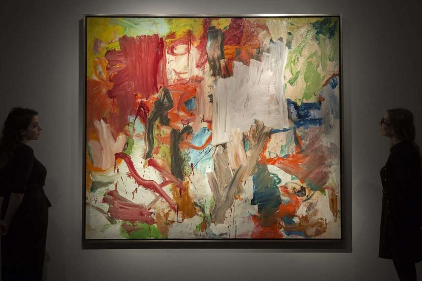 Gallery assistants look at 'Untitled XXV' by Willem de Kooning, art artwork that forms part of the New York evening sale during a press preview at Christie's Auction House in London, Britain. The piece is estimated in the range of £31million (S$54 m
