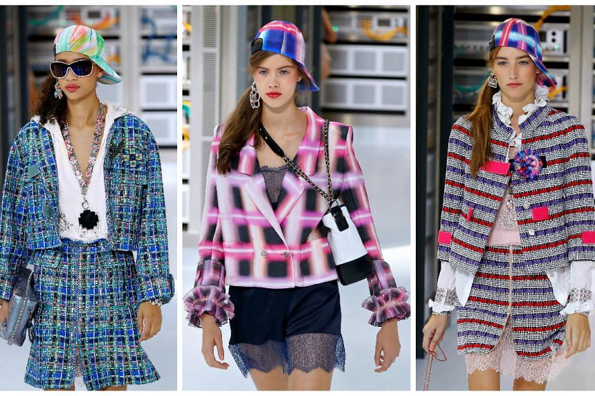 Models present creations for Chanel during the 2017 Spring/Summer ready-to-wear collection fashion show on October 4, 2016 in Paris.