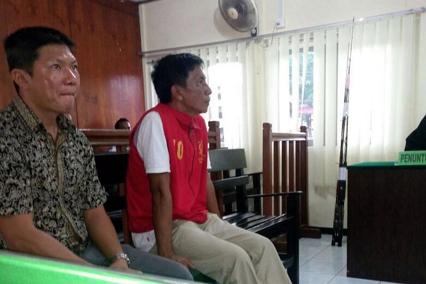 Singaporean captain Shoo Chiau Huat (right), sitting next to a Chinese language translator at a court hearing in Tanjung Pinang, Riau province, on June 20, 2016.