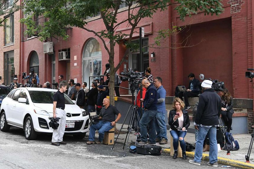 Media gather across the street from Kim Kardashian and Kanye West's town house in New York City on Oct 3, 2016.
