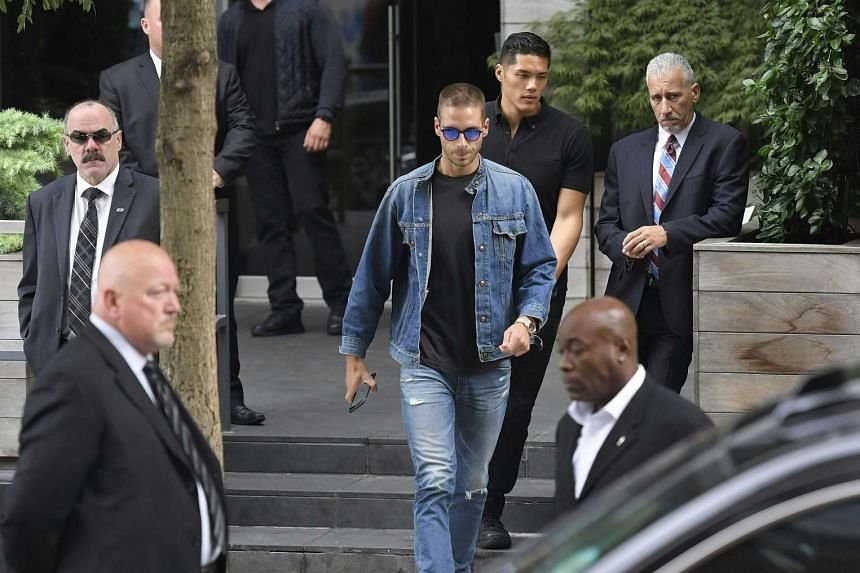 Businessman Simon Huck leaves friend Kim Kardashian and Kanye West's town house in New York City on Oct 3, 2016.
