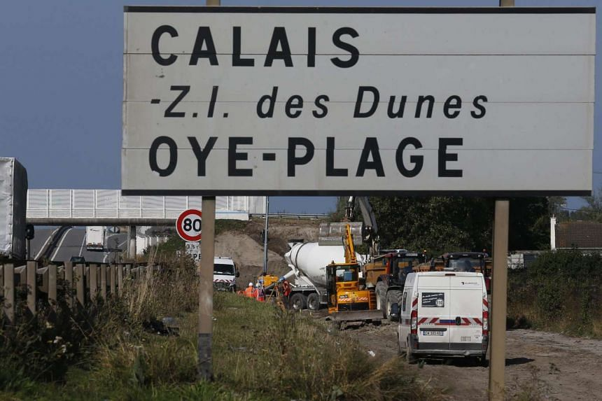 Construction work on the British-financed wall near the so-called Jungle migrant camp in Calais was opposed by its French mayor.