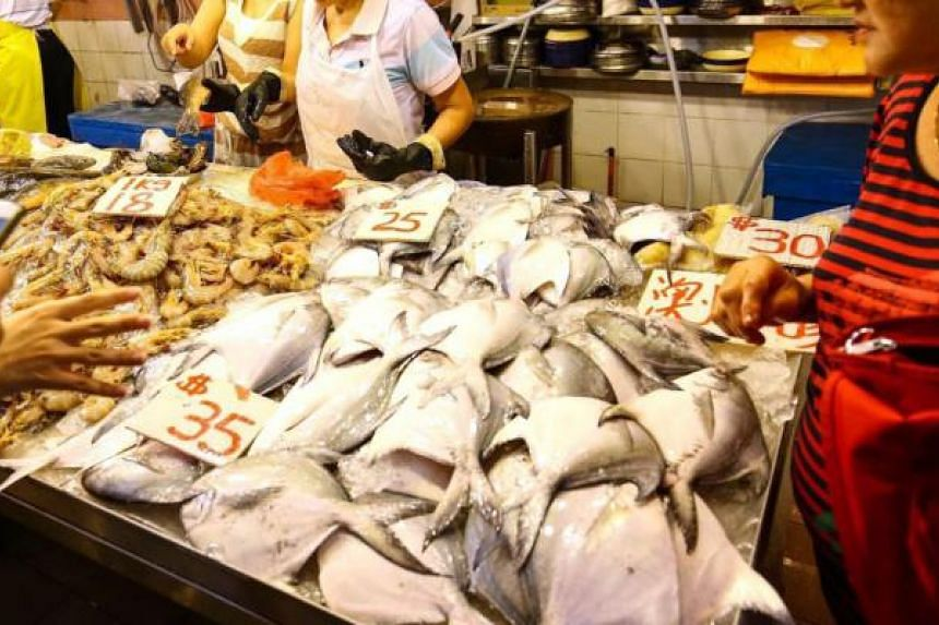 Pomfret sold at a fish stall in Chinatown Complex.