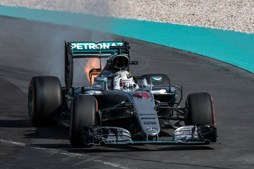 Lewis Hamilton's car being engulfed in flames from the rear during the Formula One Malaysia Grand Prix on Sunday. He later apologised for his outburst after the race in which he demanded answers from Mercedes. The Briton also made peace with his te
