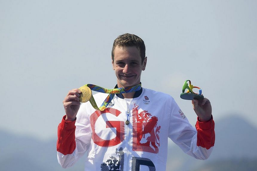 Alistair Brownlee of Britain poses with his gold medal during the 2016 Rio Olympics men's triathlon victory ceremony.