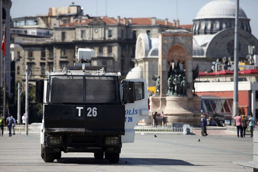 A police vehicle is parked beside the Republic Monument at Taksim Square in Istanbul after an attempted coup in Turkey. The government has extended the state of emergency for another 90 days.