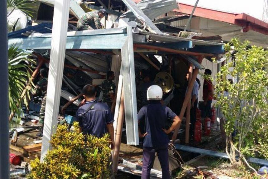 All 14 people on board the helicopter are safe after the aircraft crashed onto the roof of a school building in Tawau, Sabah.