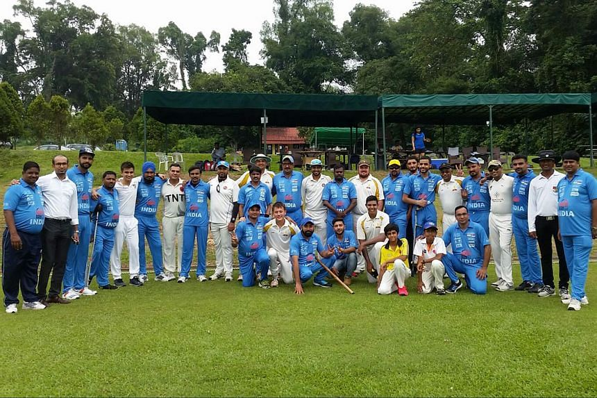 Members of the Singapore Cricket Club and the Indian Cricket Team for the physically challenged pose for a photo before the start of their friendly Twenty20 match on Oct 5, 2016.