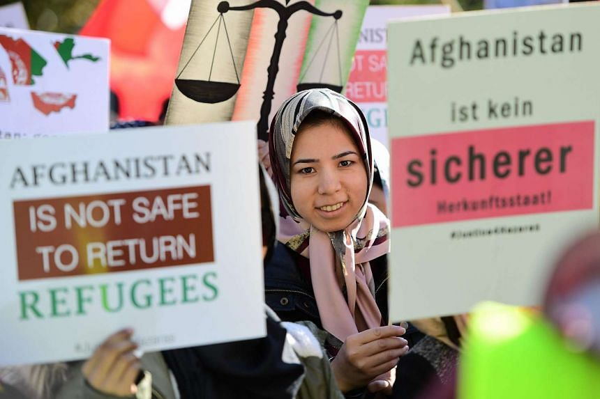 Afghani ethnic Hazaris take part in a protest calling on the Afghan government to stop discriminations against them, in front of the European Council in Brussels on Oct 5, 2016.