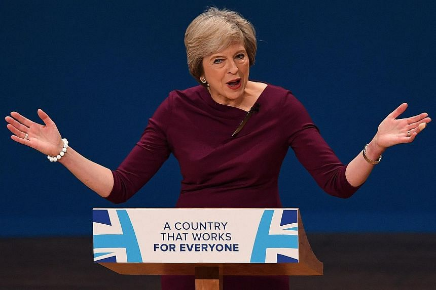 British Prime Minister Theresa May delivers a keynote address on the final day of the annual Conservative Party conference in Birmingham on Oct 5, 2016.