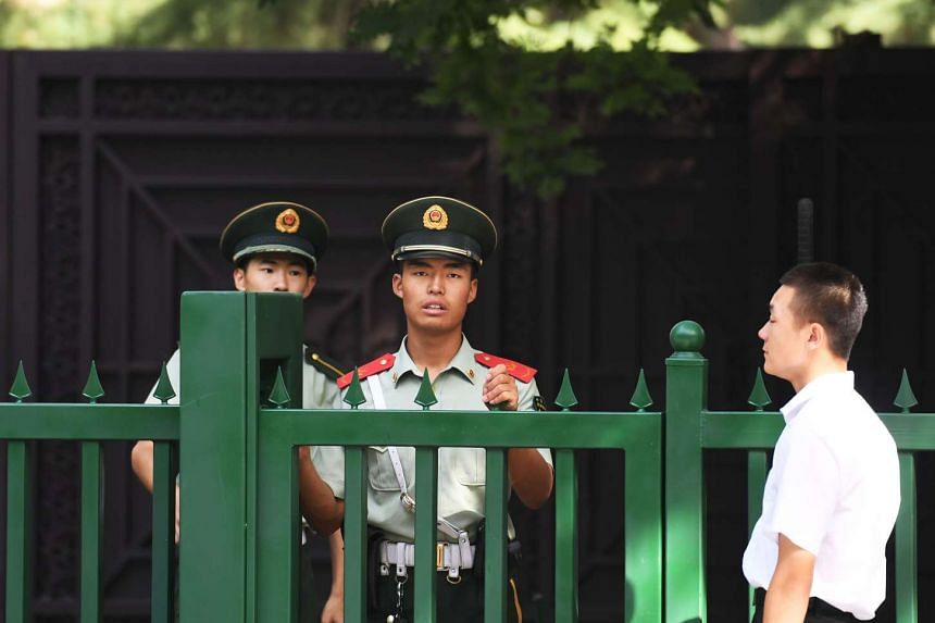 Chinese paramilitary policemen stand outside the entrance to the North Korean Embassy in Beijing.