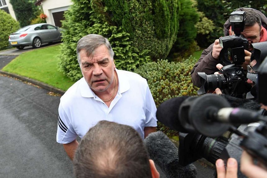 Former England national football team manager Sam Allardyce speaks to the press outside his home in Bolton on Sept 28, 2016.