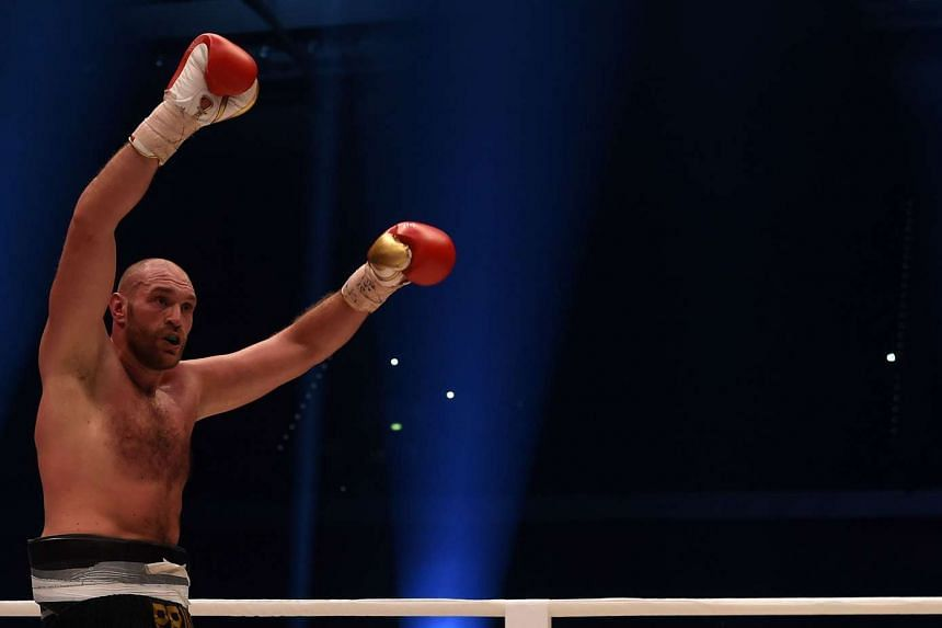 Tyson Fury celebrates after the WBA, IBF, WBO and IBO title bout against Ukrainian world heavyweight boxing champion Wladimir Klitschko in Duesseldorf, western Germany.