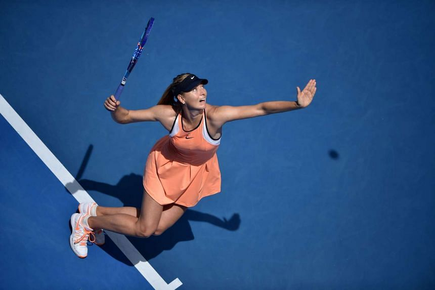 This file photo taken on Jan 26, 2016 shows Russia's Maria Sharapova serving during her women's singles match against Serena Williams of the US on day nine of the 2016 Australian Open tennis tournament in Melbourne.
