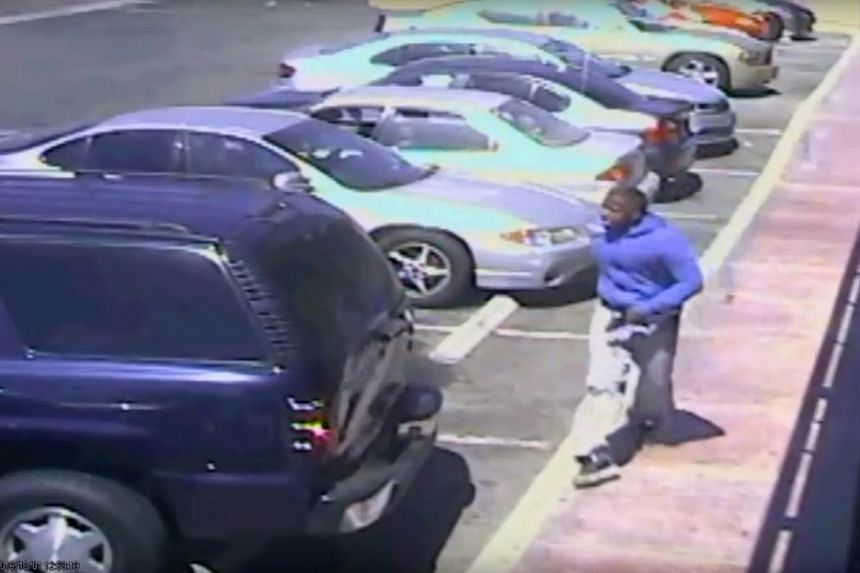 A frame grab from a surveillance video made available by the Los Angeles Police Department (LAPD) shows Carnell Snell Jr. holding a handgun moments before he was fatally shot by LAPD officers, in Los Angeles, California, USA, on Oct 4, 2016.