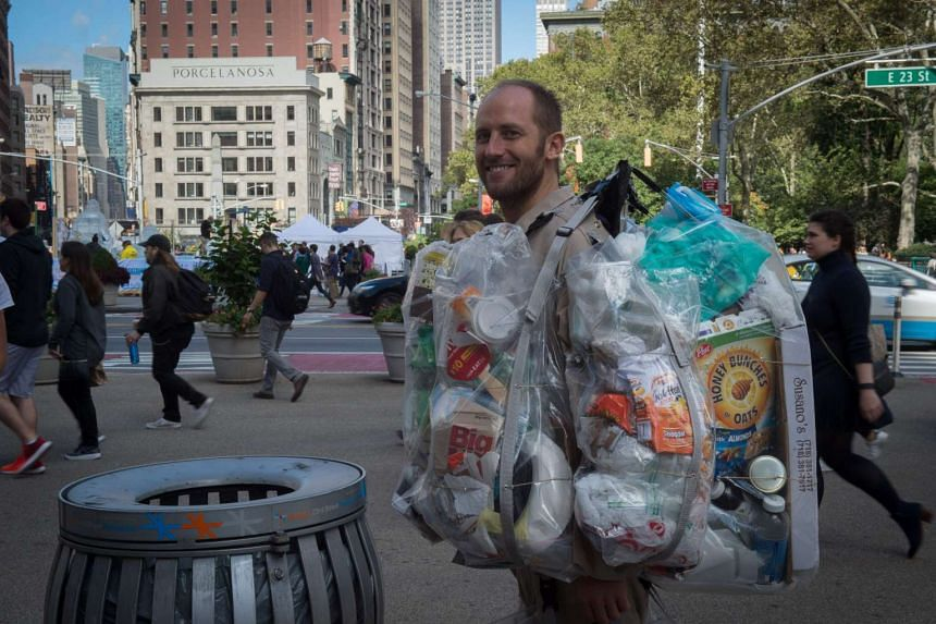 Rob Greenfield, an environmental activist who is spending a month in New York, has hanging on himself all the trash he's produced in ziplog bags on Oct 4, 2016 in New York.