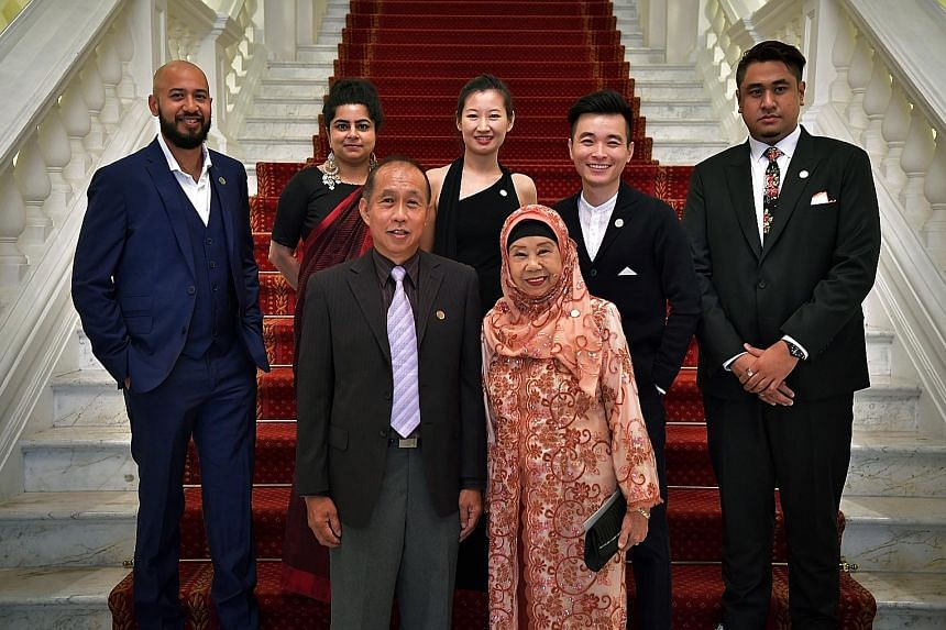 Cultural Medallion winners (front row, from left) Koh Mun Hong and Nona Asiah with Young Artist Award winners (back row, from left) Marc Nair, Pooja Nansi, Alecia Neo, Liu Xiaoyi and Ezzam Rahman, all of whom received their awards at a ceremony held