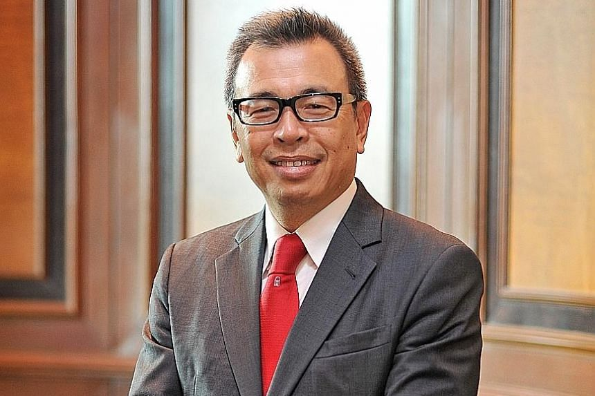 Mr Seah's (left) successor as Prudential Singapore CEO is Mr Wilfred Blackburn.