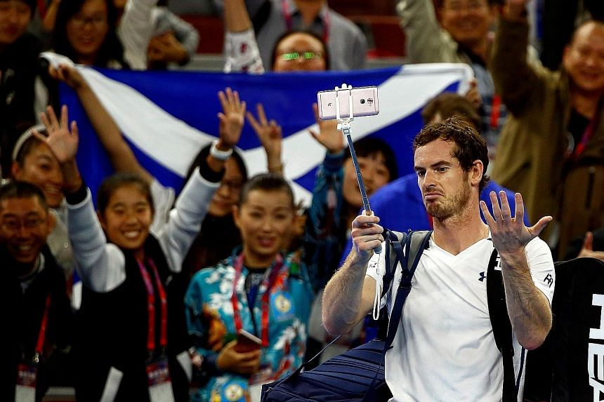 World No. 2 Andy Murray gesturing at a malfunctioning selfie stick after beating Italian Andreas Seppi at the China Open in Beijing yesterday.