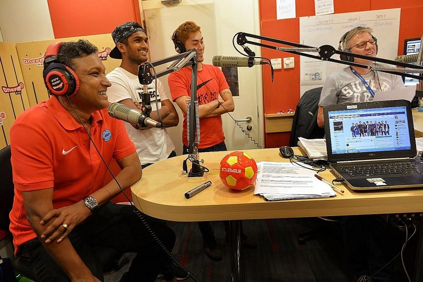 (From left) Singapore national caretaker coach V. Sundramoorthy and Lions midfielders Hariss Harun and Gabrial Quak having a chat with DJs Glenn Ong (not pictured) and the Flying Dutchman during ONE FM's morning show. They were promoting Friday's fri