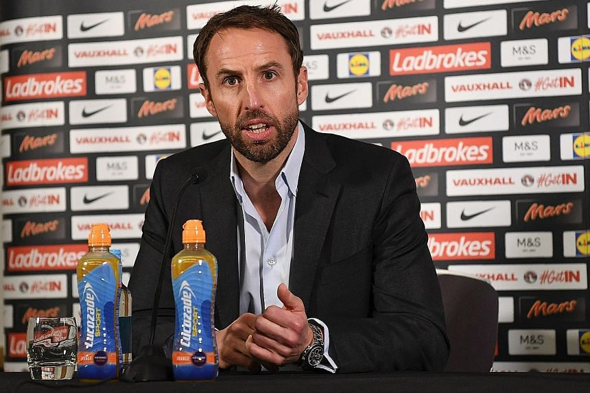 England interim manager Gareth Southgate giving a press conference ahead of England's World Cup qualifier against Malta. He believes that his captain Wayne Rooney can play in a number of different positions rather than solely as a striker.
